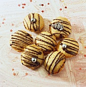 Biscuits with chocolate drizzle and silver pearls