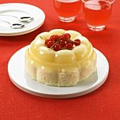 Turned-out vanilla pudding on sponge base