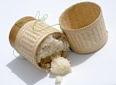 Bamboo basket of sticky rice, fallen over