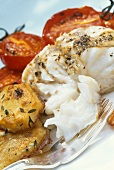 Halibut with fried potatoes and tomatoes