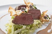 Roast venison fillet with white cabbage