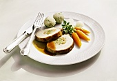 Stuffed loin of pork with herb dumplings