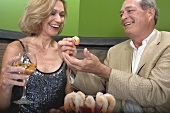 Man and woman eating shrimps in restaurant