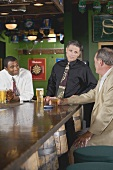 Three men at the bar in a pub