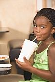 Girl in restaurant drinking a soft drink
