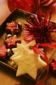 Star biscuits and Christmas decorations in a box
