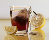 A glass of fruit tea with lemon
