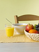Still life with juice, fruit and cornflakes