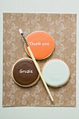 Three international biscuits with paintbrush