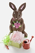 A chocolate Easter Bunny with Easter decorations