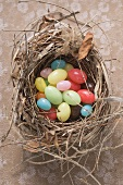 Coloured Easter eggs in Easter nest (overhead view)