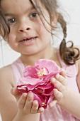Girl holding rose petals
