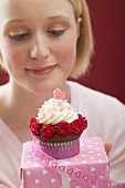Young woman with cupcake and Valentine's Day gift