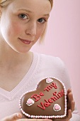 Young woman with a chocolate heart for Valentine's Day