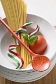 Spaghetti with Italian ribbon, basil and tomato