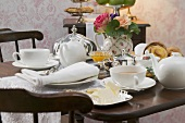 Tea things and butter dish on attractively laid table