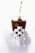 Cola & sugar cubes (picture symbolising high sugar content)
