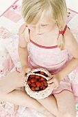 Blond girl with fresh raspberries (from above)