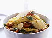 Spaghetti with spinach, cocktail tomatoes & Parmesan shavings