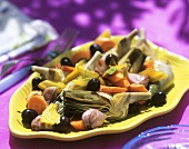 Artichoke and carrot salad with garlic and black olives