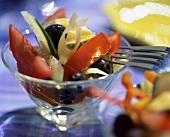 Tomato and cucumber salad with leeks and black olives