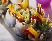 Herring rolls filled with cucumber, peppers and onions