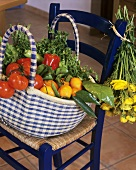 Bag of fresh fruit and vegetables on a chair