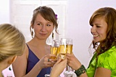 Young women clinking glasses of champagne
