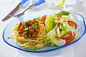 Diet lunch: spaghetti (low-fat preparation) and salad