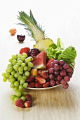 Plate of fruit: grapes, melon, pineapple, strawberries etc.
