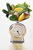 Fresh fruit, vegetables and eggs on scales