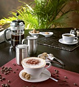 Cappuccino in café setting with coffee beans