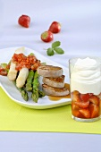 Pork medallions with asparagus & strawberry dessert with cream