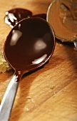 Dark couverture in a spoon