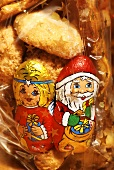 Christmas figures and cookies in starry bag