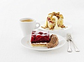 Raspberry square, small cake with cream & a cup of coffee