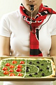 Spinach pizza with tomatoes & olives (football pitch)