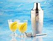 Citrus fruit cocktail with cocktail shaker & bar strainer