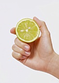 Hand holding half a lime
