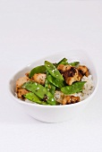 Chicken breast with mangetout and sesame seeds on rice