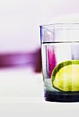 A glass of mineral water with a slice of lime