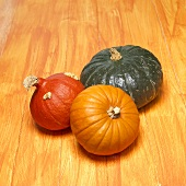 Three pumpkins on orange background