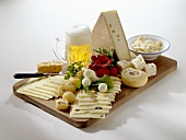 Bavarian cheese board with radishes and beer