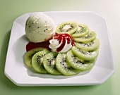 Kiwi ice cream, kiwi fruit slices, cream, strawberry sauce