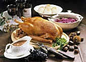 Roast goose with chestnut stuffing, red cabbage & dumplings