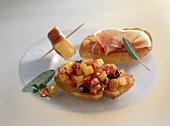 Bruschetta, Parma ham on bread and fried polenta cube