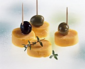 Cheddar cheese and olives on cocktail sticks