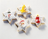 Star-shaped biscuits decorated with sugar figures