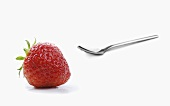 A strawberry and a spoon
