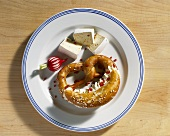 Pretzel filled with soft cheese and Camembert